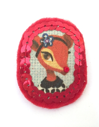 Brooch Lane, print on fabric, sewed on red felt with red beads