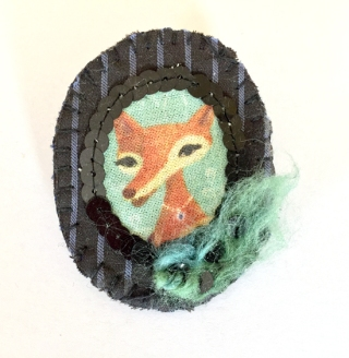 Teta Lija, sewed on felt andblack striped fabric, with turquoise wool, decorative black beads